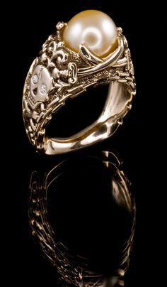 Yellow South Sea Pearl Ring  PR-604 would want it with a black pearl and rubies for the skull eyes