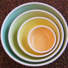 Pottery Nesting Bowls - Large Set of Stoneware Bowls in Spring Colors. $90.00, via Etsy.