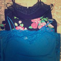 3 Cami/Camisole Bundle A bundle of three camisoles. All are stretchy and can fit various sizes. Two lace ones are a size M, and floral cami is a size L but all fit the same. All in good condition. Lace camis have lace bottoms as well. Ambiance Apparel Tops Camisoles