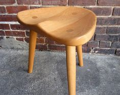 "Stools handmade to order in walnut, cherry, or white oak. (31 walnut pictured)  These stools are available in sizes ranging from 18 to 30 tall. They are completely hand made by me in Asheville, NC. These stools are made from local sustainably sourced hardwoods, and built to be a family heirloom. The seats are hand shaped and very comfortable! 15% discount on orders of 3 or more  18""- $400.00 (30 table height) 25""-$575.00 (36 standard kitchen counter) 27""-$600.00 (38 tall counter)…"