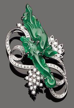 A thick jadeite and diamond dragon brooch