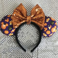 Purple and Orange Mickey pumpkin mouse ears. These are perfect for the Halloween season at the parks! The headband is hand wrapped covered with black fabric and lined on the inside. My ears are all made to be puffy at about 2 inches wide, these are not flat! If you need an item quicker, please message me! I may have some items completed and ready to ship. Due to the nature of the fabric, the product may be slightly different then the one you see here, but will look mostly the same. If you... Disney Diy, Disney Crafts, Baby Disney, Disney Mickey Ears, Minnie Mouse Bow, Disney Halloween Ears, Parks, Disneyland Ears, Disney Pumpkin