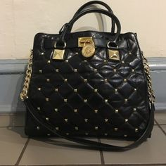 Michael Kors Hamilton black studded bag Black quilted leather bag with gold studs across front and bag. 2 handles for forearm and an over the shoulder strap Michael Kors Bags Totes