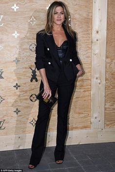 Jennifer Aniston wearing Louis Vuitton Spring 2017 Leather Bustier Top and Louis Vuitton Petite Malle Clutch
