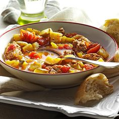 Hearty Minestrone Soup Recipe -This fresh-tasting minestrone soup gets its zesty flavor from Italian sausage. When you want to use up your garden bounty of zucchini, try this recipe. If your family likes food extra spicy, use hot bulk Italian sausage instead. —Donna Smith, Fairport, New York