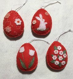 This lovely handcrafted set of Easter egg hanging ornaments is bright coral felt. The ornaments are decorated with felt flowers, embroidery and glass beads. Each is approximately 3.25 X 2.5 inches. Not recommended for young children. A nice Easter gift or decoration for your home. They