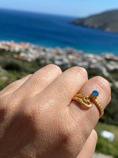 Gold octopus ring blue gem ring tentacle ring gold | Etsy Garnet Rings, Garnet Gemstone, Blue Rings, Silver Rings, Cheap Rings, Unique Rings, Octopus Ring, Evil Eye Necklace, Blue Gemstones