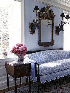 great slipcover made out of a periwinkle blue and white quilt
