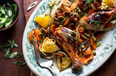 Melissa Clark roasts juicy chicken thighs with carrots, onions and dates for a twist on a classic dish for the Jewish holidays.