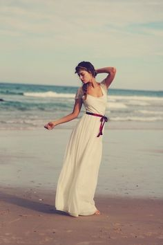 Seaworthy Wedding Dresses: A Beach Wedding Dress Guide - Idea for beach photoshoot if we make it this year: white dress with red ribbon/belt