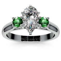 The colour of the year adds that crucial punch of fresh green beauty to this classy piece by Brilliance: The Round Emerald Gemstone Engagement Ring in Platinum, featuring a Pear-cut center diamond and 2 flanking round emeralds! www.brilliance.com
