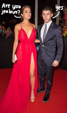It's Easy To See Why Nick Jonas Still Gets Jealous!! GF Olivia Culpo Displays Sexy Cleavage & Thigh Beside Him At Cannes!