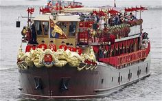 The Spirit of Chartwell, carrying members of the royal family, approaches Westminster Bridge during the Queens Diamond Jubilee Pageant on the River Thames (REUTERS)