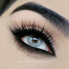 Love the smokey black eyeshadow and liner paired with fluttery lashes