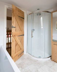 Ledged and braced oak doors finished with Pewter Patina ironmongery gives a touch of class to this bathroom in an oak frame house designed and supplied by Border Oak. Similar fittings from Willow Wood Front Doors, Oak Doors, Cottage Door, Cottage Homes, Oak Framed Extensions, Border Oak, Oak Framed Buildings, Oak Frame House, Off Grid House