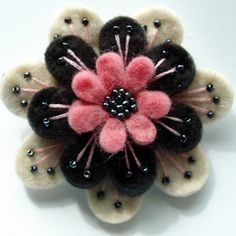 A beautiful, feminine brooch made from 3 layers of scrumptiously soft wool felt.Embroidered and beaded with hematite-effect seed beads, and firmly attached to a 1
