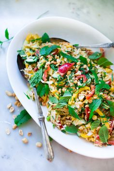 Thai Vegetable Crunch Salad with mint, thai basil and scallions and a light peanut ginger dressing- vegan and gluten free| www.feastingathome.com