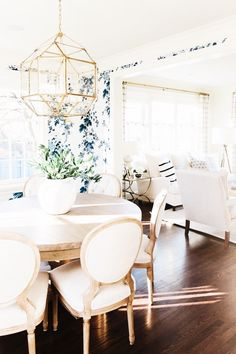 Love the floors, table and chairs, lighting, and navy combo.