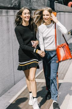 3 Items We Don't Wear With Sneakers - - What are the cool ways to wear a dress with sneakers? We're taking a few tips from fashion girls. Sneakers Fashion Outfits, Dress With Sneakers, Sneaker Outfits, Black Sneakers, New York Fashion Week Street Style, Model Street Style, Sandro, Denim On Denim, Sneakers Street Style