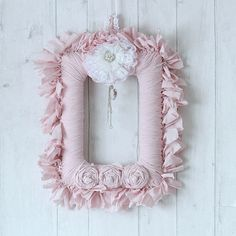 This Shabby Chic Pink Wreath features a square flatback styrofoam wreath covered in pink cotton fabric strips. I have also added some handmade rolled roses and a hanger for the wreath using the same cotton fabric and lace. A handmade lace flower has been added to the top along with a piece of jewellery which hangs in the middle which finishes the wreath of beautifully. This beautiful wreath will add a touch of class to any home decor all year round. This would also be a lovely wedding…