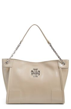 A cutoutTory Burch logo enhances the understated sophistication of this swank patent-leather shoulder bag that's perfect for all year round.