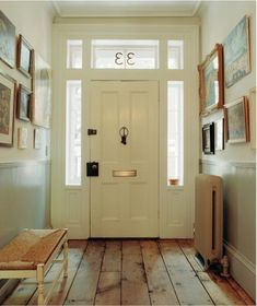 Just finished stripping an old pine floor today!! The entire room is white..What a great contrast..and this  pic looks exactly  like it this foyer including my exterior doors!! LOVE IT!!!