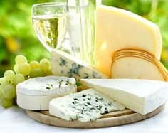 Enjoying life in the sun with friends while eating fromage and drinking white wine.