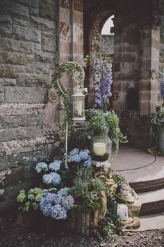 Woodsy wedding decor with lanterns and hydrangeas | Image by Ten21 Photography