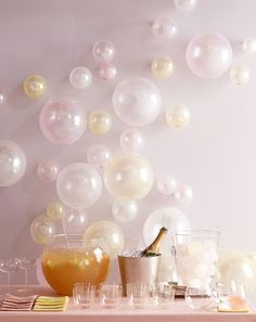 Very cool party decoration idea. The balloons on the wall look like champagne bubbles...