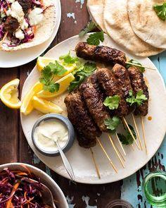 Lamb Koftas on a platter served with pita bread, minted cabbage salad and yogurt sauce Turkish Recipes, Greek Recipes, Romanian Recipes, Scottish Recipes, Yogurt Recipes, Ethnic Recipes, Ground Lamb Recipes, Lamb Koftas, Mint Salad