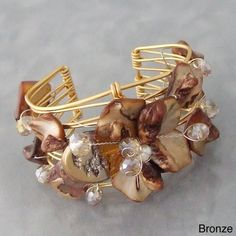 Goldtone Seashell Floral Cuff Bracelet (Philippines) | Overstock.com Shopping - The Best Deals on Bracelets