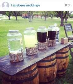 Outdoor Country Wedding done by LizzieBees| drink stations, wooden barrels, mason dispensers, wedding drink stand