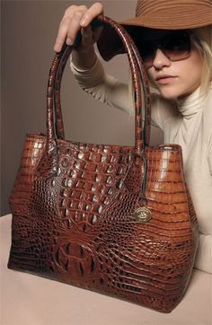 "Brahmin.  i have one in RED!  i <3 it and want more pieces.  my first ""big girl"" purse purchase."