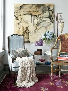 Beautiful composition of furniture and decorative items.  The art is off the hook.