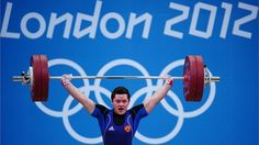 Natalya Zabolotnaya of Russia lifts to set a new Olympic Record in the Women's 75kg Weightlifting Final on Day 7 of the London 2012 Olympic Games at ExCeL.