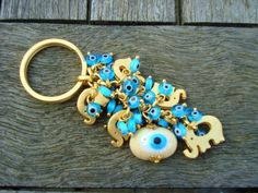 Evil Eye Beaded Keychain with Little Gold Elephant by cocolocca, $14.50