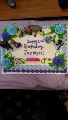 Frozen Party. No Frozen party is complete without a frozen cake (ice cream cake). Got a plan cake from Baskin Robbins with some flowers and we dressed it up with the Frozen cast. We bought the figurine set at Jcpenney.