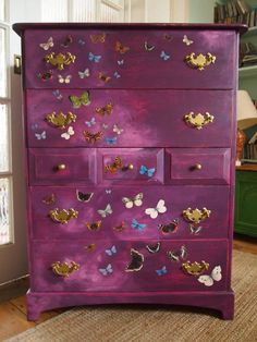Vintage chest of drawers painted in purple, distressed and the decorated in butterflies using the decoupage technique
