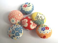 Fabric button set of 6 cute designs, cat and florals mix. $8.00, via Etsy.