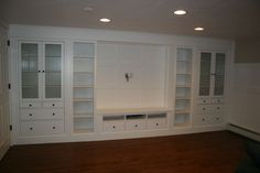 When renovating my basement I knew I wanted a wall of built ins. Keeping my budget in mind I created that feature using IKEA bookshelves from the Hemnes line. V…