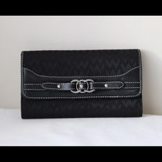 """Black chevron wallet Black colored chevron printed wallet - snap closure - inner and outer sipper pockets - plenty of card slots - front design detail - 4.5"""" x 7"""" - like new! Bags Wallets"""