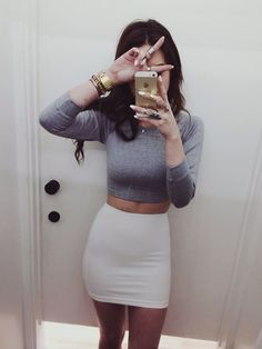 White skirt & gray long sleeve crop top. Fashion: dress/skirts