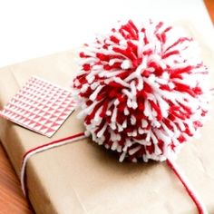Pom pom madness for the holiday season. From gift bows, to ornaments, to garlands, they are the perfect accent this season!