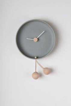 'totide wall clock - gray' created by Italy-based designer federica bubani has a playful swinging ball pendulum