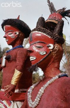 Figures in masks and Tribal dress.