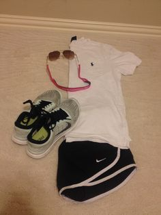 Southern preppy lazy outfit. Perfect for walking around but still looking cute! Frocket polo, aviators w/ vineyard vines croakies, nike shorts, and nike free runs