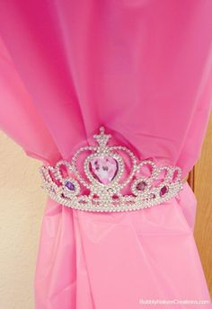 Tie back curtains using princess tiaras. | 26 Ideas For The Ultimate Disney Princess Bedroom