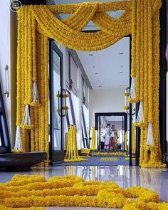 Yellow marigold with white tassles for traditional entrance. Desi Wedding Decor, Wedding Hall Decorations, Marriage Decoration, Backdrop Decorations, Wedding Entrance, Halloween Parejas, Traditional Wedding Decor, Mehndi Decor, Entrance Decor