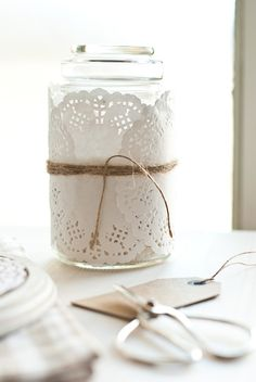 Jar wrapped in doilies and jute twine