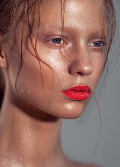 Dewy ,almost wet look, bronzed skin, bleached brows, bright lip